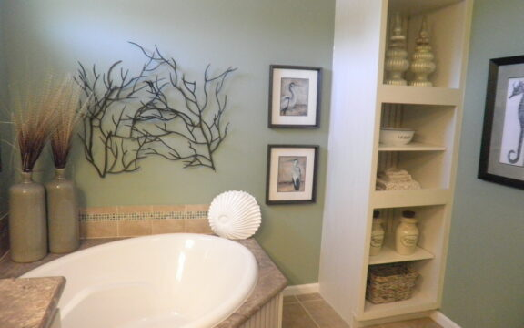 Master bath in the Wellington X348F6 by Palm Harbor Homes with built in storage.