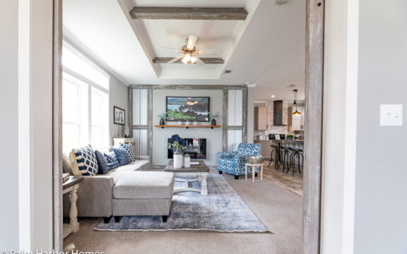 From the Den/Studio back into the living area in The Cottage Farmhouse by Palm Harbor Homes. 2 bedrooms 2 bathrooms. 1,387 square feet with built in porch. Only available in Florida. LS28522J
