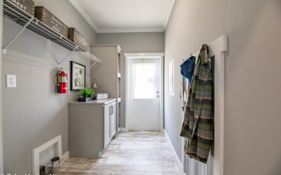 Laundry room in The Cottage Farmhouse by Palm Harbor Homes. 2 bedrooms 2 bathrooms. 1,387 square feet with built in porch. Only available in Florida. LS28522J