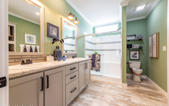Master bath in The Cottage Farmhouse by Palm Harbor Homes. 2 bedrooms 2 bathrooms. 1,387 square feet with built in porch. Only available in Florida. LS28522J