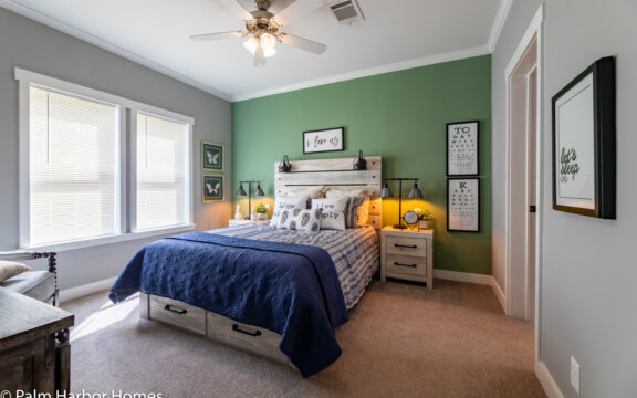 Master bedroom in The Cottage Farmhouse by Palm Harbor Homes. 2 bedrooms 2 bathrooms. 1,387 square feet with built in porch. Only available in Florida. LS28522J