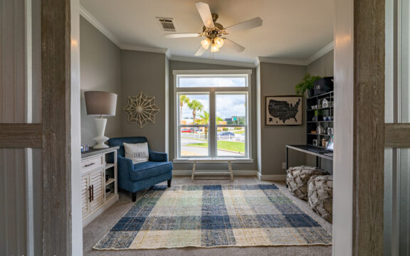 The den or studio/office in The Cottage Farmhouse by Palm Harbor Homes. 2 bedrooms 2 bathrooms. 1,387 square feet with built in porch. Only available in Florida. LS28522J