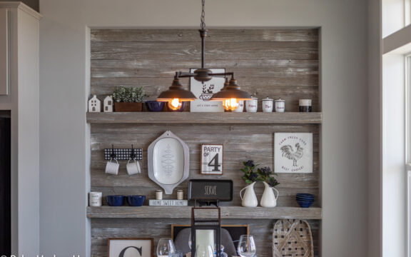 Feature wall in dining area of The Cottage Farmhouse by Palm Harbor Homes. 2 bedrooms 2 bathrooms. 1,387 square feet with built in porch. Only available in Florida. LS28522J