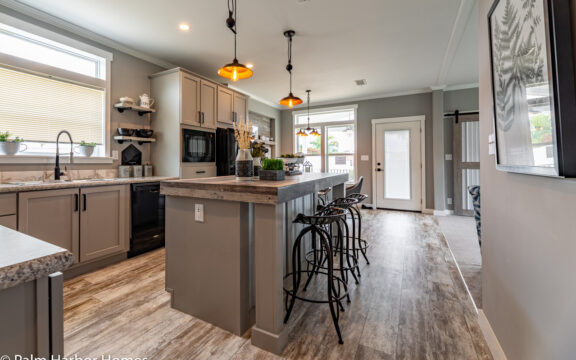 The Cottage Farmhouse by Palm Harbor Homes. 2 bedrooms 2 bathrooms. 1,387 square feet with built in porch. Only available in Florida. LS28522J